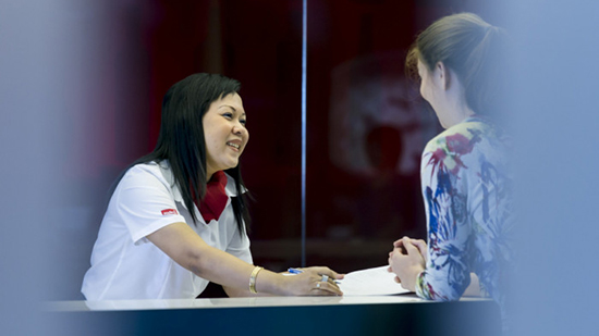 Sodexo receptionist employee talks to customer at the reception desk
