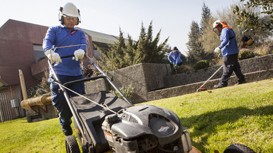 Sodexo employee mows the lawn
